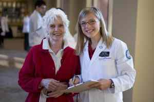 Senior with DMU student at Senior Health Fair