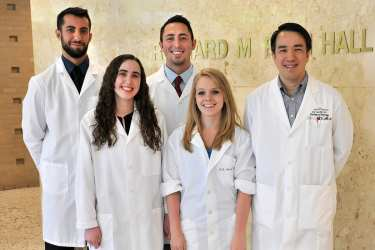 Kim Tran, M.D., Ph.D., right, supervises several student researchers at a time. They've included Vahe Matnishian and Robert Clements, back row;  Lara Terry, now a doctoral student at the University of Rochester, and Briana Gebert-Oberle, now a research  assistant in DMU's physiology/pharmacology program. She and Terry completed the program this past summer.