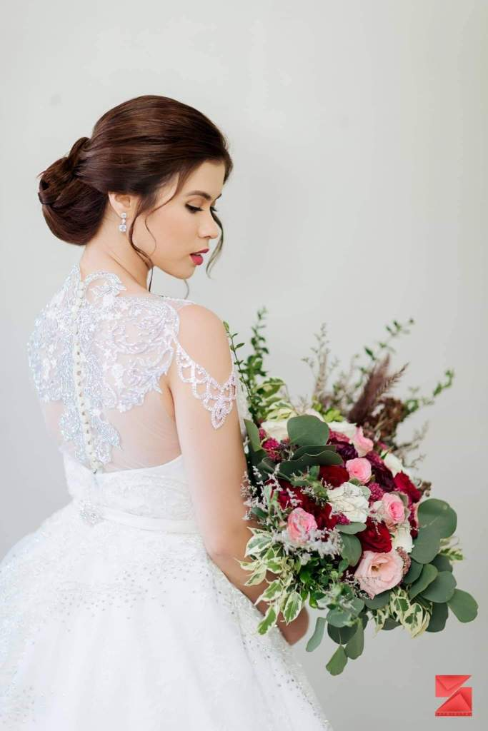 Timeless.  There is something about lace gowns that made them a favorite of brides wanting to make their special day even more special. Photo furnished to DNX by Migi Dujon
