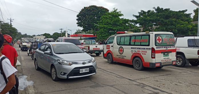 A Red Cross ambulance is among those that responded to the fire call early this afternoon.