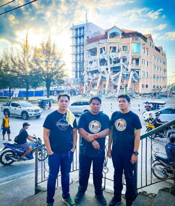 Hinobaan Councilor Jason Tupas (leftmost) with Pastor Russel Ban (center)  and Engineer Christian Aguirre survey damage to property caused by the series of earthquakes in Mindanao, such as this hotel. Photo grabbed from Jason Tupas' FB page
