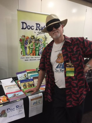 Jenner selling Doc Rat merchandise at ConFurgence 2017, Melbourne, Australia.