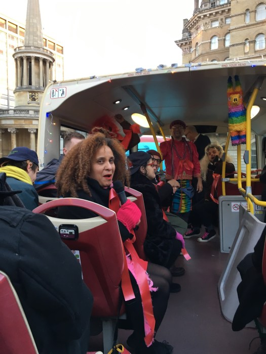 A photo of people on an open top bus