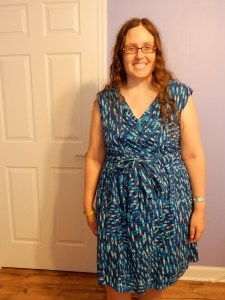 Veronica wearing a dress with many shades of blue