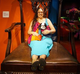 Veronica and Hestia sitting in a VERY big chair