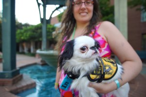 Hestia and her Hufflepuff vest in front of a fountain