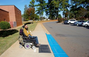 Brad in front of newly painted curb cut