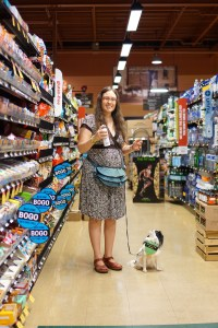 Veronica faking it till she makes it with a smile, with Hestia at the grocery store.