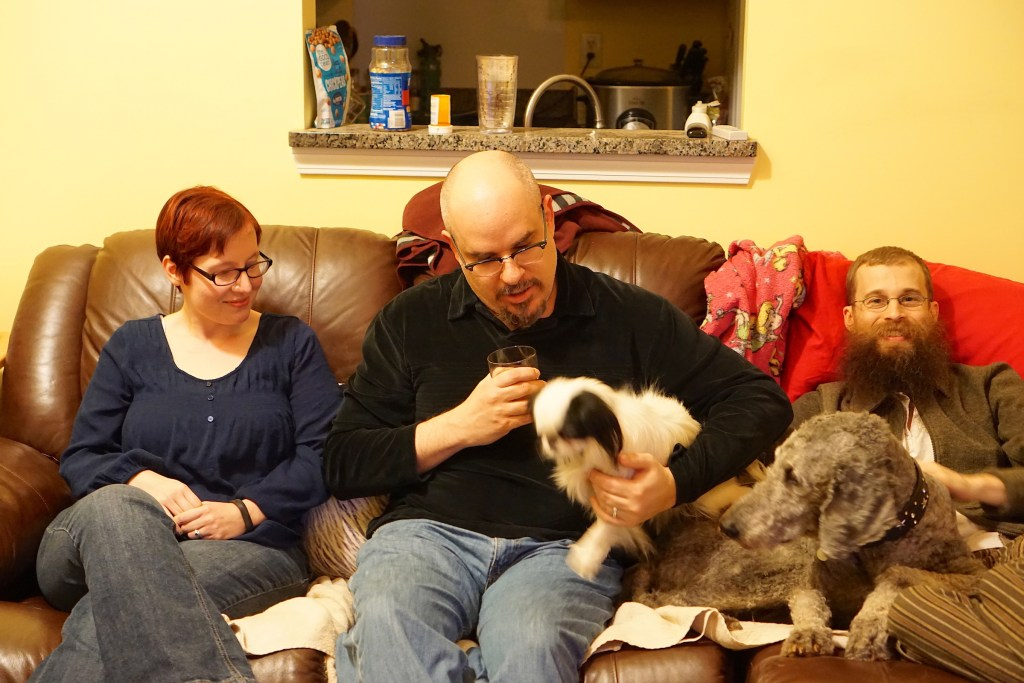 Melissa, CJ, Brad, Ollie and Hestia on the couch.  Everyone is looking at little Miss Hestia!