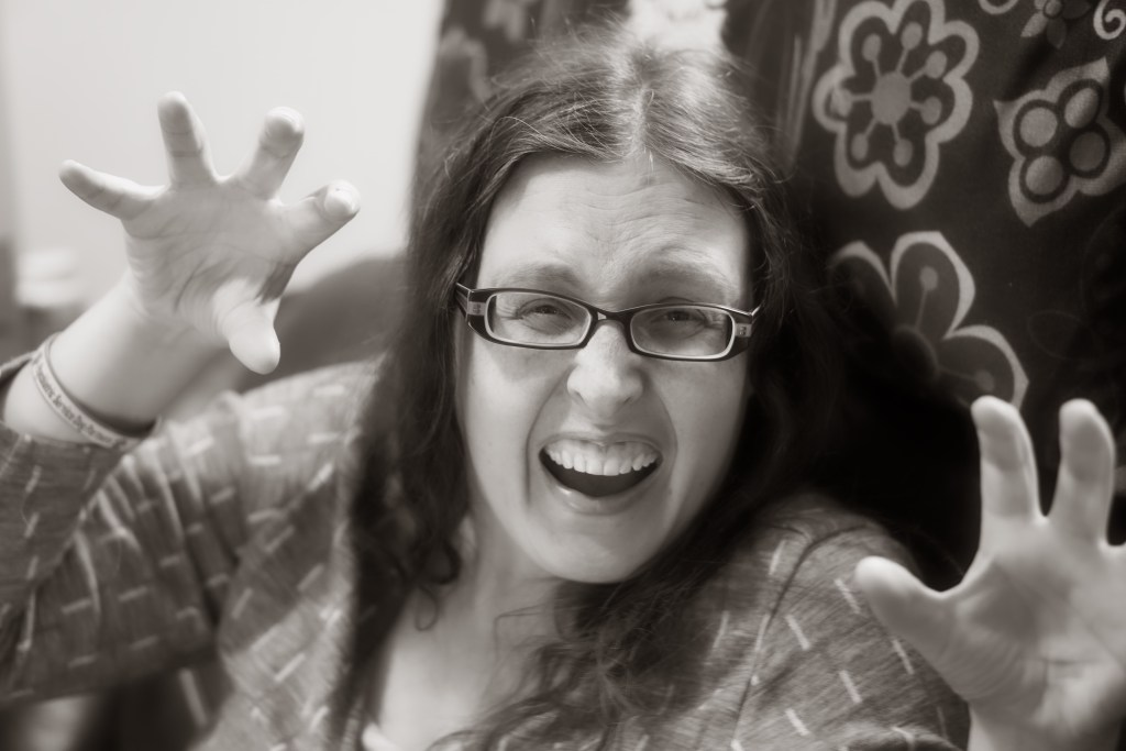 Black and white photo of Veronica pretending to be a Jaguar.  Why a Jaguar?  Only Brad knows.