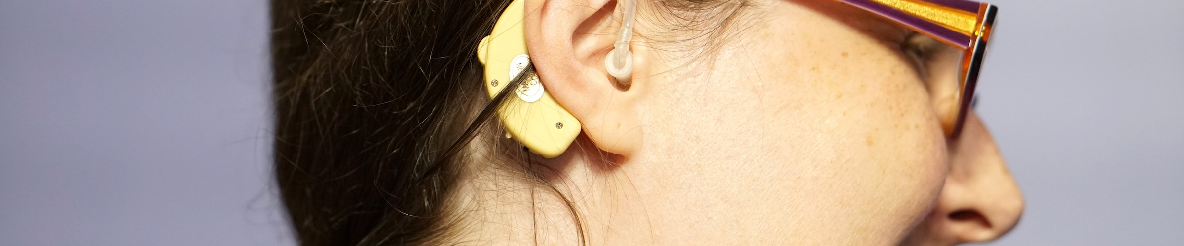 With the hair fully back you can see the entire hearing aid.