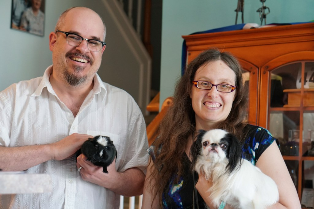 CJ holding the guinea pig named Madonna, and Veronica holding Hestia.  Hestia is looking at the camera.