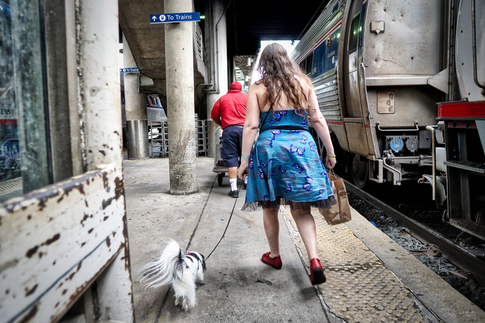 Veronica and Hestia from the rear walking through the maze of trains that is the Amtrak platform.