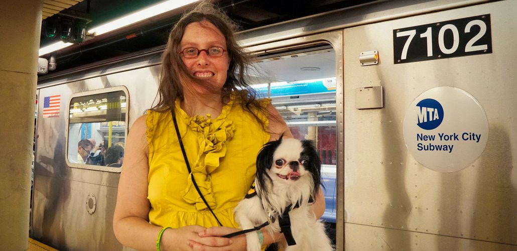 Veronica and Hestia, both in yellow, catch the breeze of an arriving subway train.