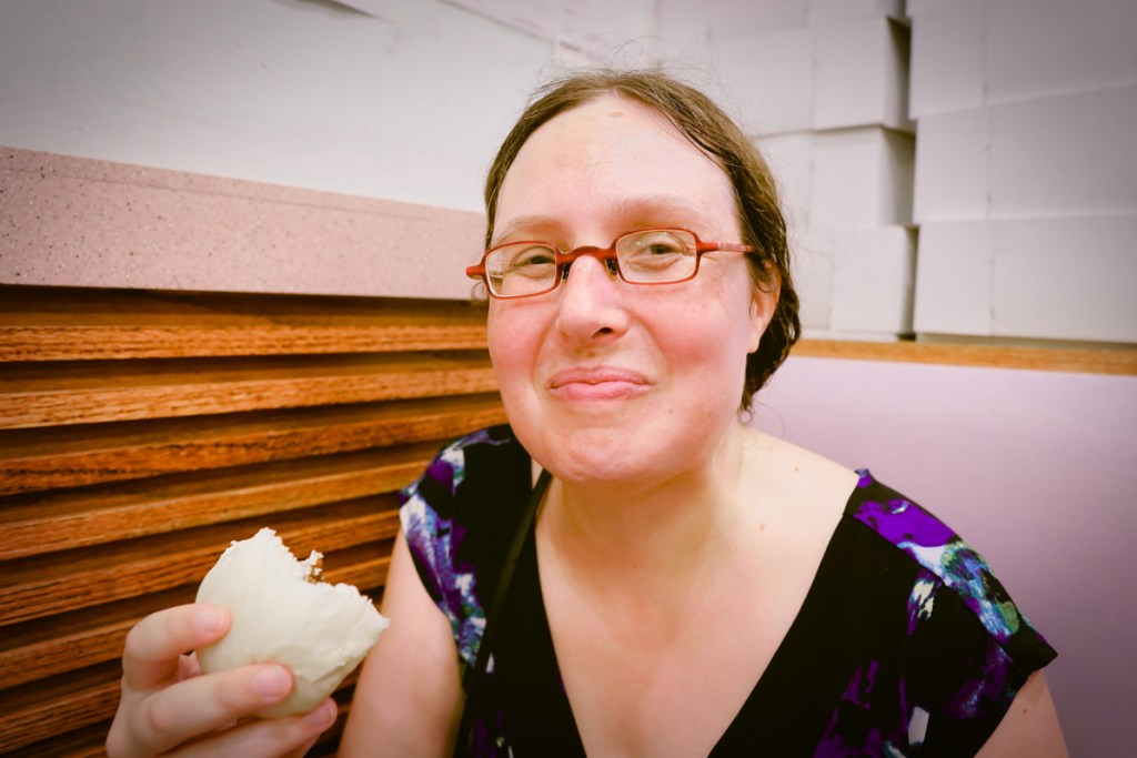 Veronica smiles as she chews a yummy lotus bun!
