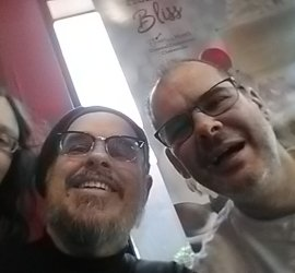 A selfie of me, Dan and CJ. Dan and CJ have beards and DJ is wearing a hat. I am out of focus and have hair in my face LOL! That's the kind of picture you get without a Brad there to make everything look good!