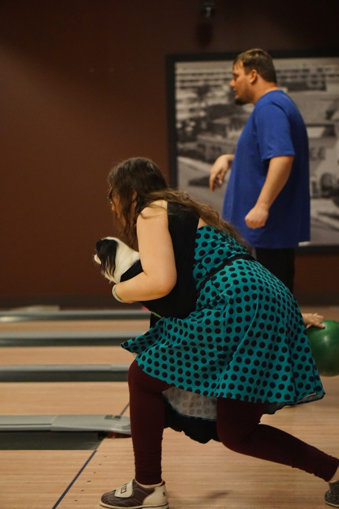 Veronica about to release the bowling ball, and Tommy standing in the background.