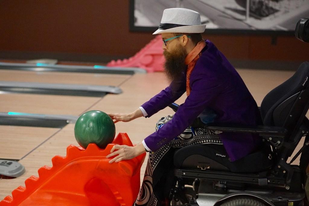 Brad lets go of his bowling ball