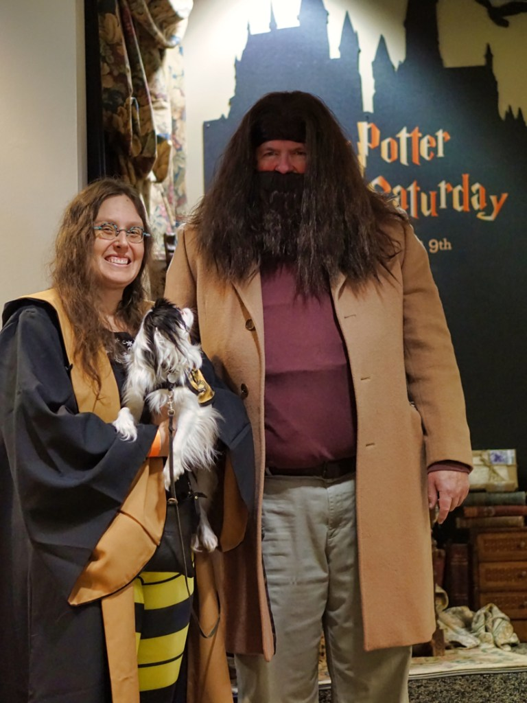 Veronica and Hestia with Hagrid.  Hestia is craning her neck to look up at Hagrid, trying to figure out what he is!