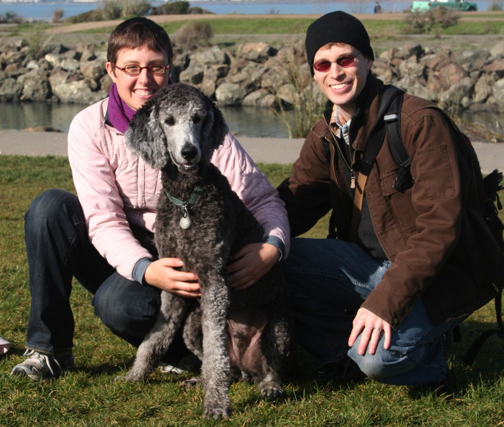 Family photo of Brad, Veronica, and Ollie at the park.