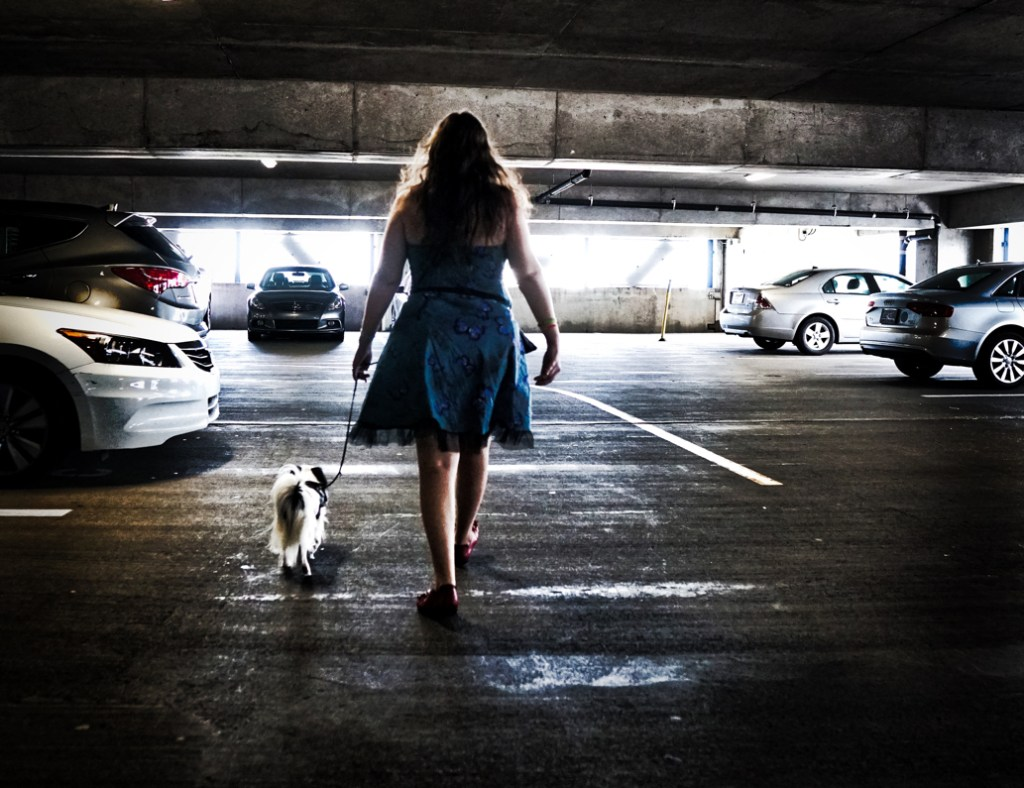 A powerful image of Veronica and Hestia walking through a car park