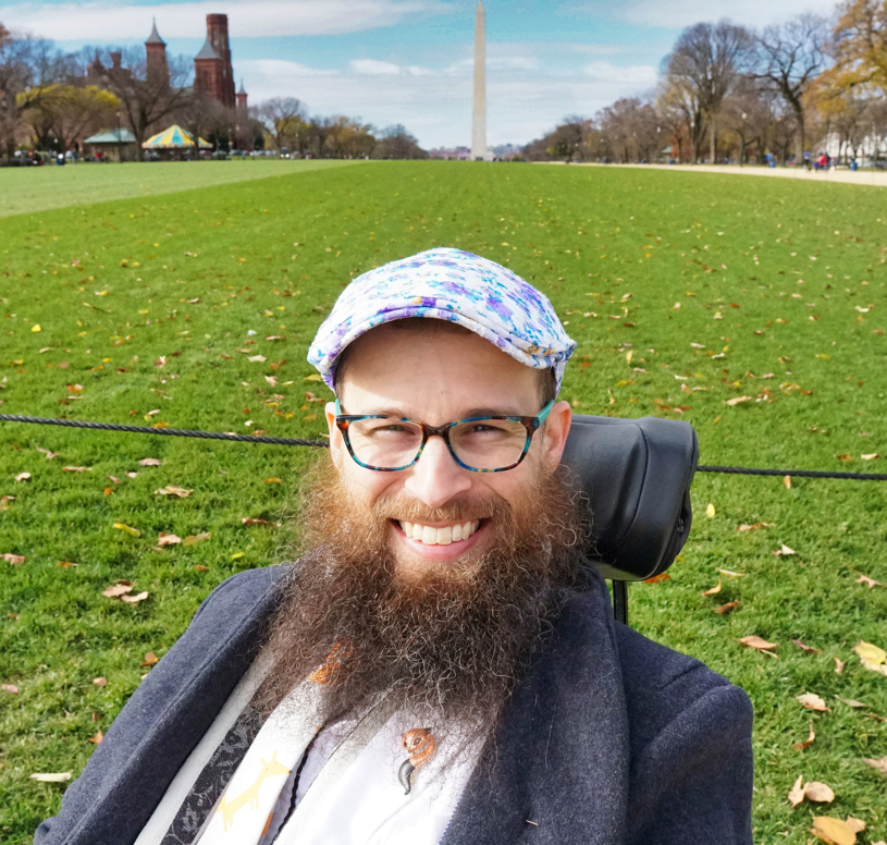 A closeup of Brad with the Washington Monument in the background.  His hat is particularly beautiful in this picture.