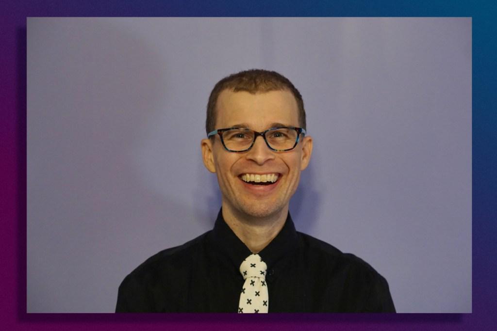 Clean-shaven Brad smiling.