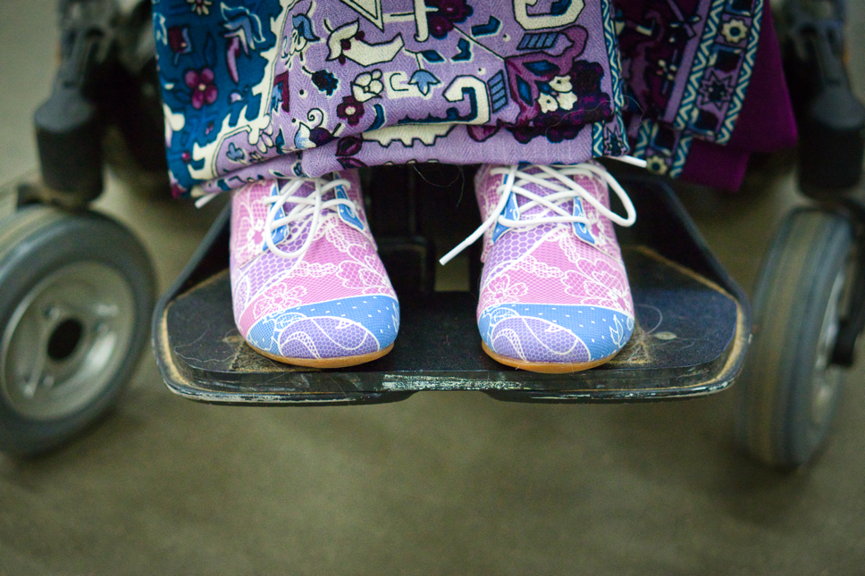Resting on the footplate of his wheelchair are Brad's new and very exciting shoes!