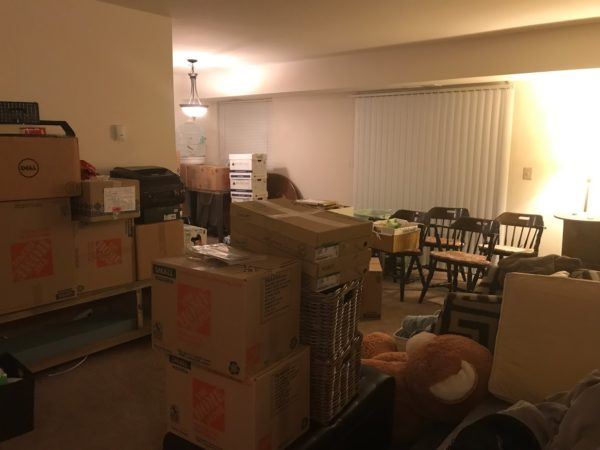 rental apartment filled with packed boxes