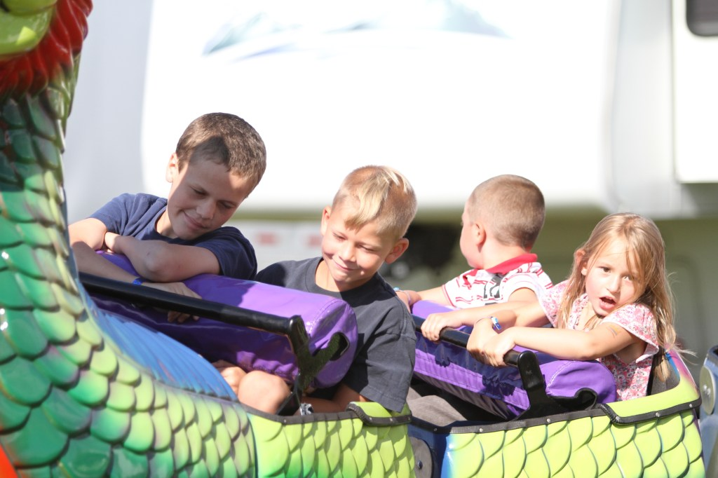 Kids ride the Dragon Roller Coaster at DCFair Beaver Dam WI