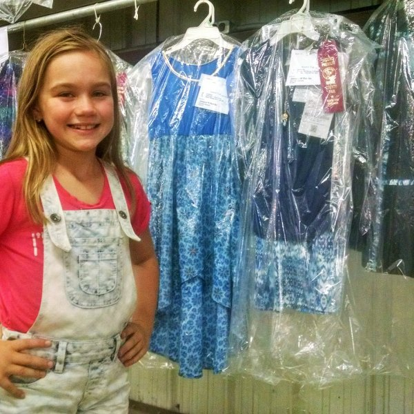 Professional youth model exhibits in 4-H clothing project