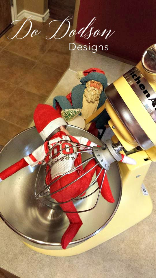 Elf on the shelf mischievious ideas playing ring around the Kitchen Aide.