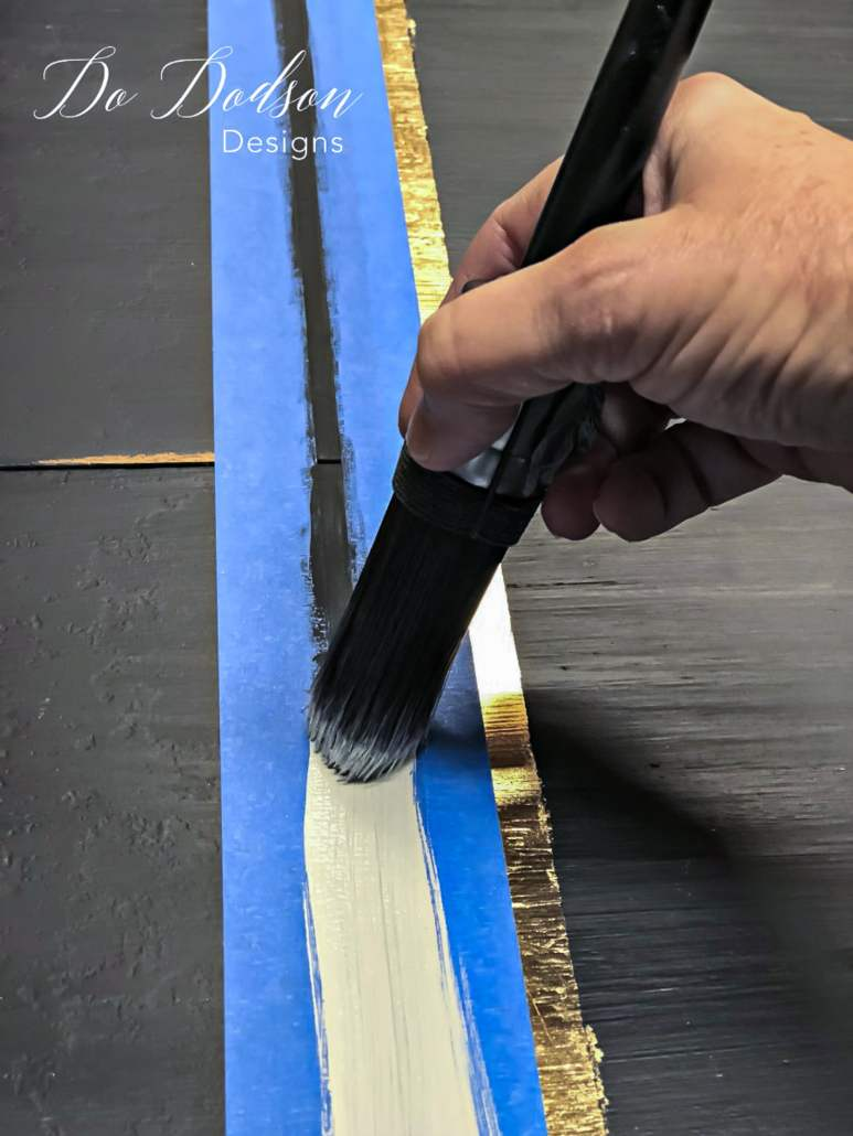 How to paint stripes on furniture like a pro and without bleeding.