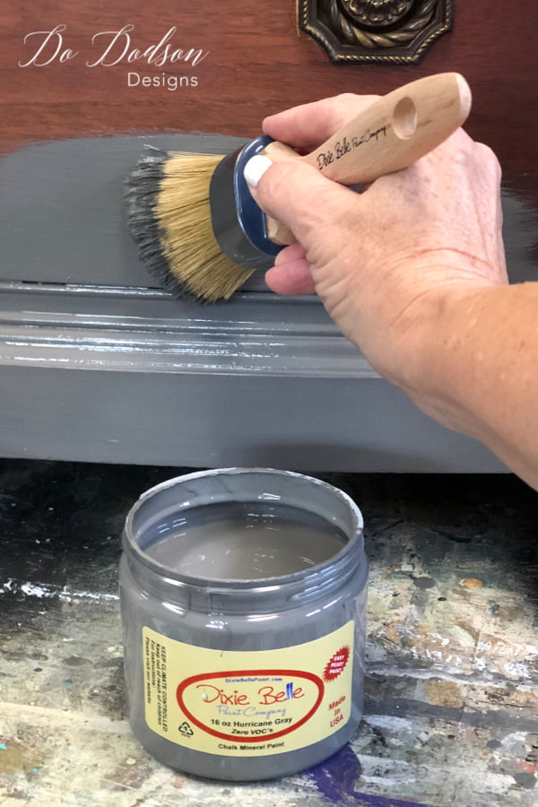 Painting the base coat with Hurricane Gray with the first step in the layered paint process to get the old world finish.