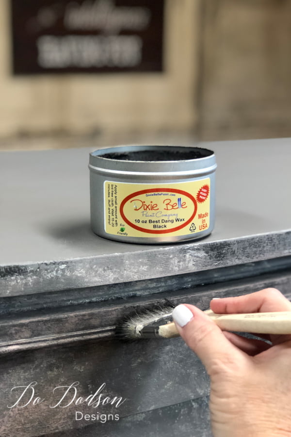 I added black wax with a chip brush to bring out the details in the layered paint finish.