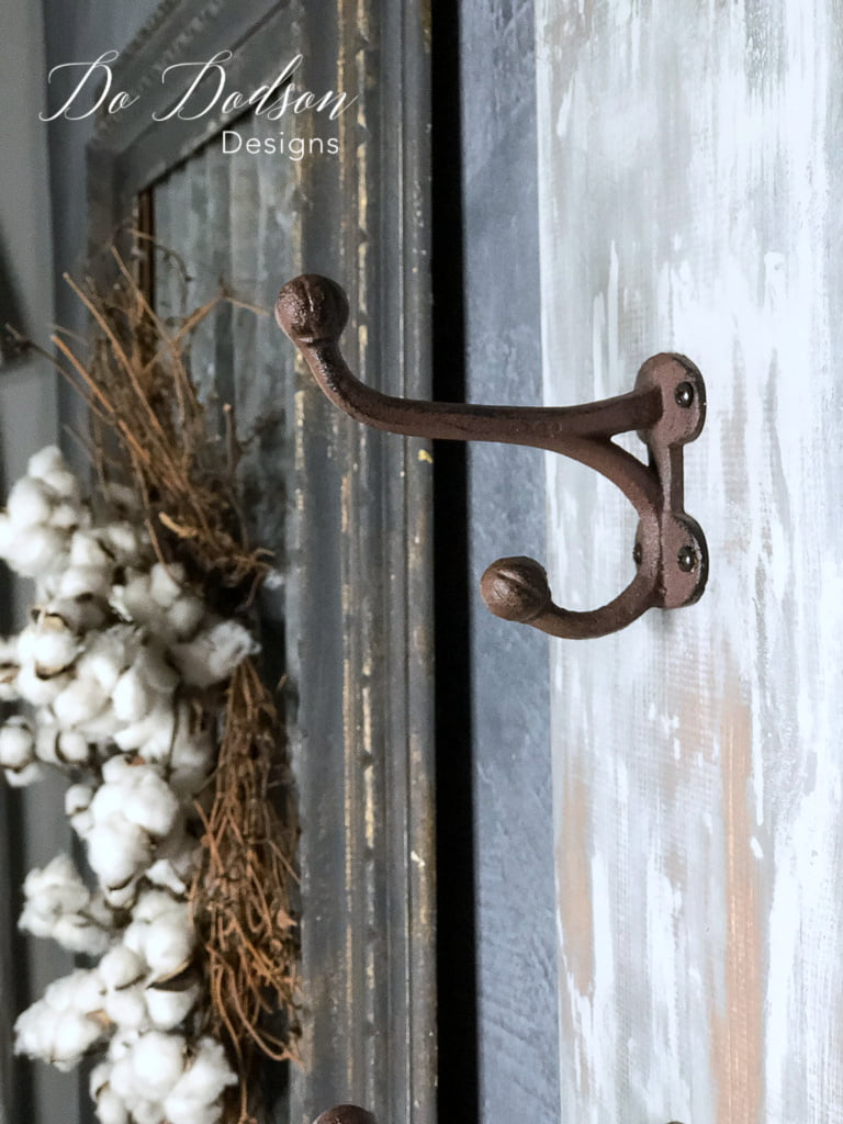 I love the look of these rustic wall coat hanger hooks with the weathered paint finish on this.