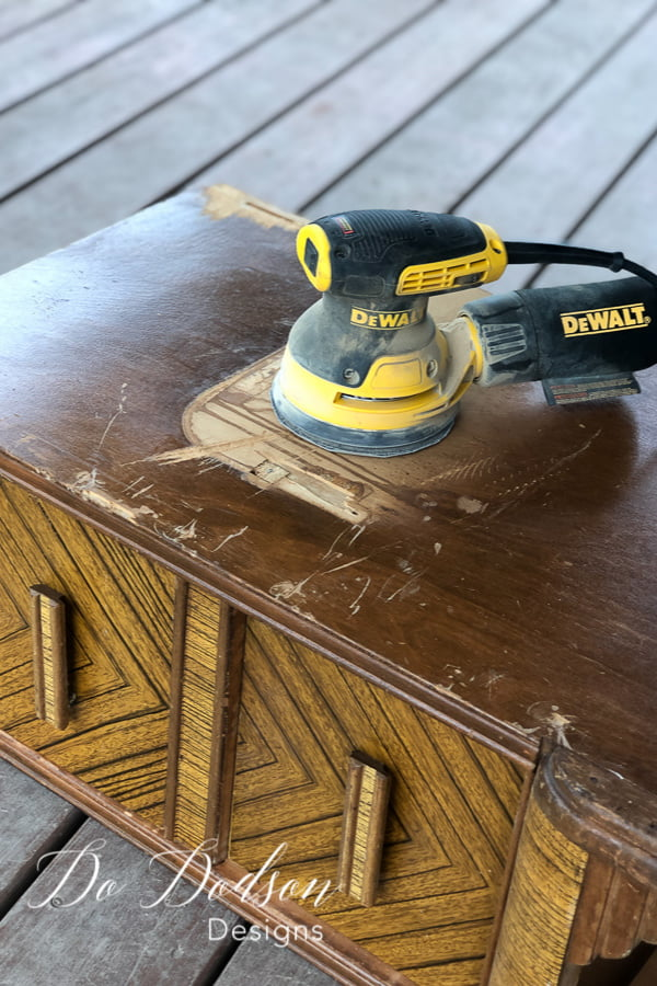 I used a rotary sander to smooth out the rough areas of the damaged wood before applying the easy wood filler.