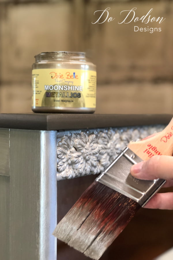 Using a quality synthetic paintbrush is the key to beautiful metallic painted furniture.