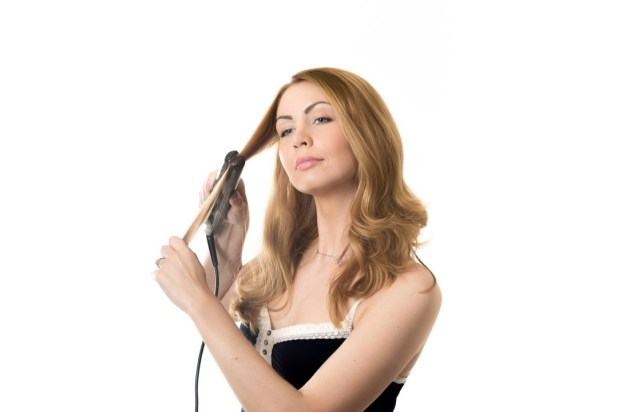 Top 5 Best Hair Extension to Get Natural Looking Hair Young woman with hair straightener