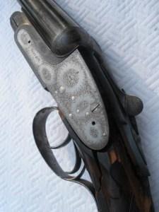 Busted up Boss 20g double barrel shotgun
