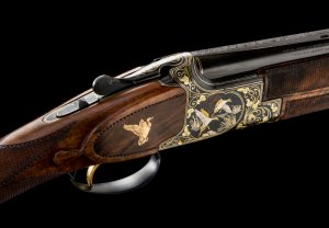 One-of-a-Kind Angelo Bee Exhibition Grade Engraved and 4-Color Gold Inlaid Belgian Browning Model 25