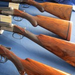 Fox shotguns at the Fox Collector's table. Check out that straight-gripped 20 gauge!