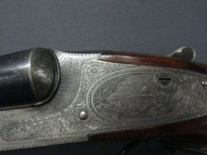 Lot 300: L.C.Smith double barrel Crown Grade 12ga Highly engraved 30in steel barrel length of pull14in SN 68025