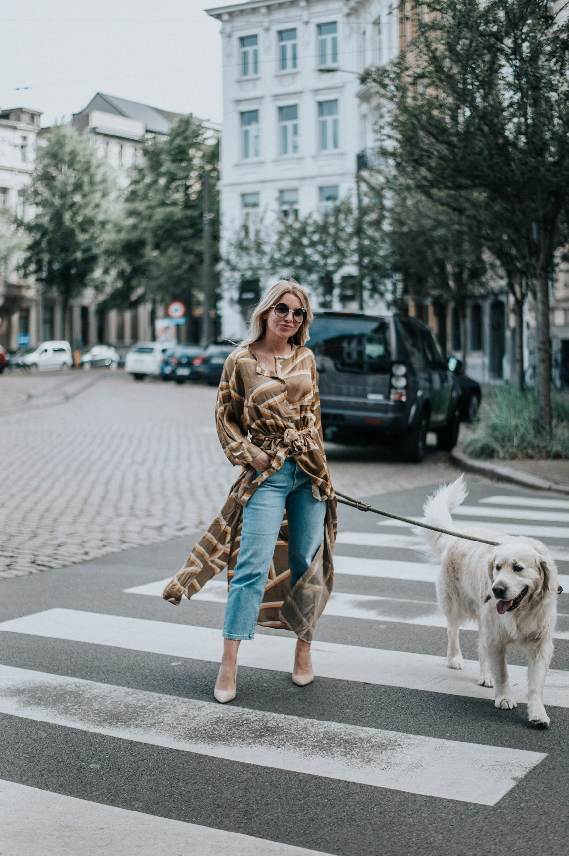 wearing the Second Female Sonja LX Maxi Dress with jeans and heels