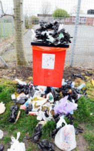 dog poo bin overflowing