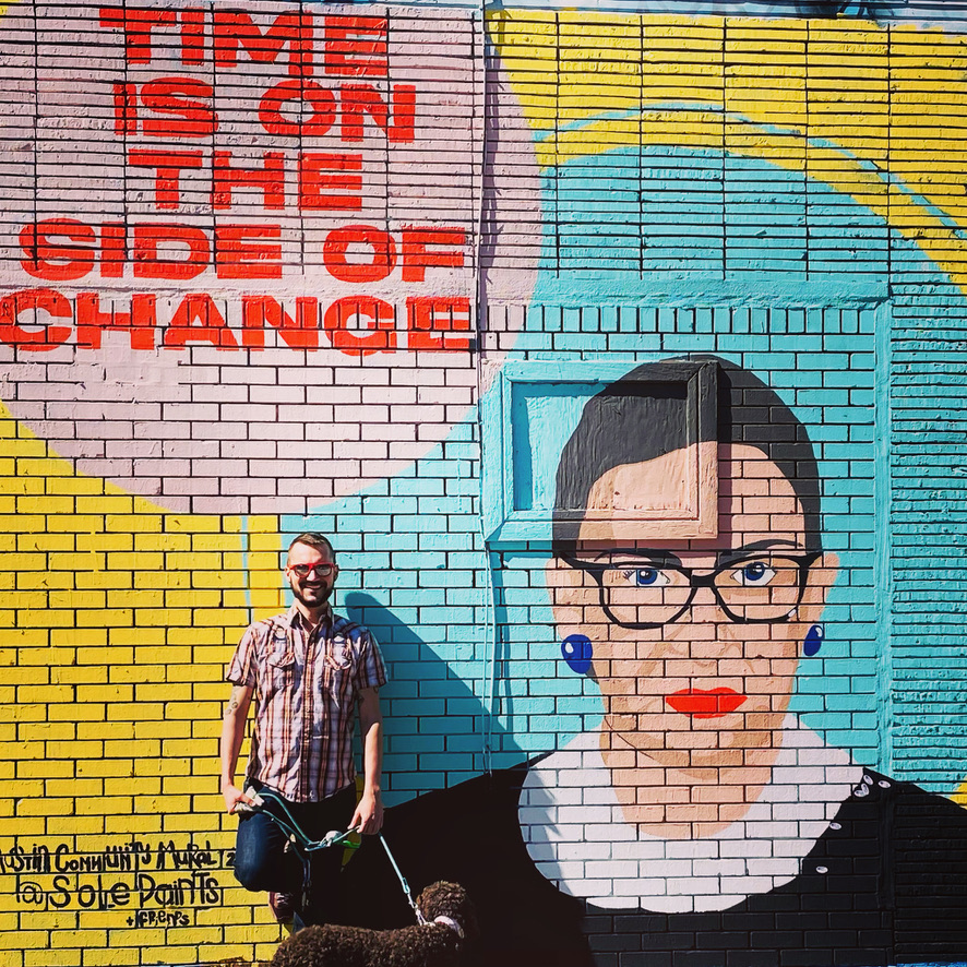 Bobby and Molly in Austin, Texas, in October 2020, in front of an RBG mural