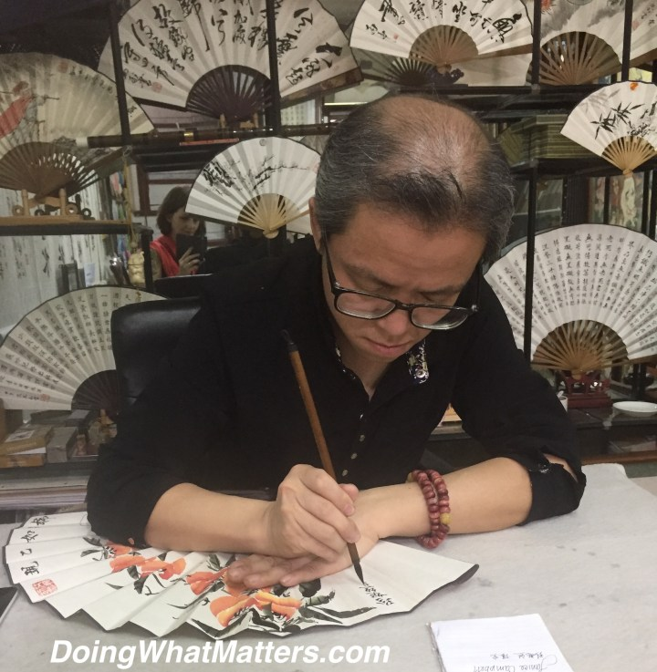 Calligraphy artist at work.