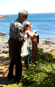 Amélie is hoisted up by Father Jocelyn at Nicks Cove