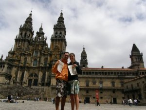 Celebrating the completion of the Camino de Santiago in front of the church of Saint James... two minutes before we got engaged