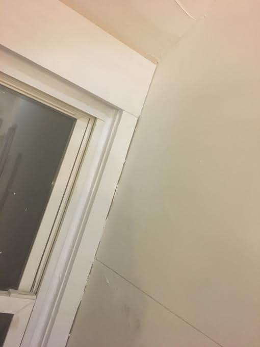 window trim to wall tile transition in